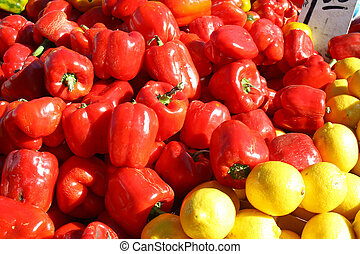 Pile of Bright Red and Yellow Bell Peppers at Farmer's Market