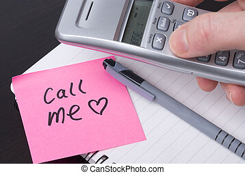 CALL ME message on pink postit note