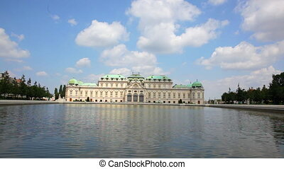 Belvedere palace is reflected in fountain water, Vienna,...