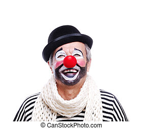 Senior clown looking to the copy space area