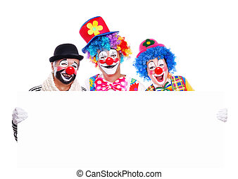 Three clowns with blank - Three smiling clowns holding the...