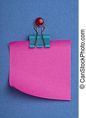 Pink postit on blue - Pink postit note on blue background...