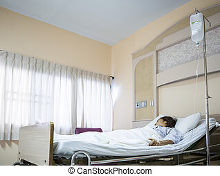 Woman patient in hospital bed