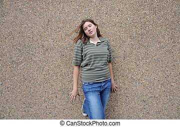 Female tomboy - Female tomboy expressions against a wall...
