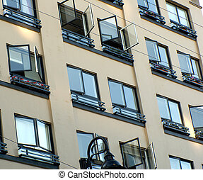 Open Windows - Downtown apartment building windows in...