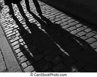 Furtive shadowsof a couple in the street. - Paris, France,...