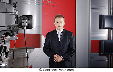 middle age news presenter and video camera