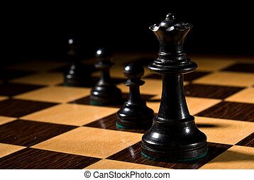 Chess queen leads pawns on chessboard - Chess board with...