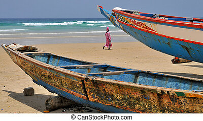 Fishing boats - Colorful fishing boats on a beach in...
