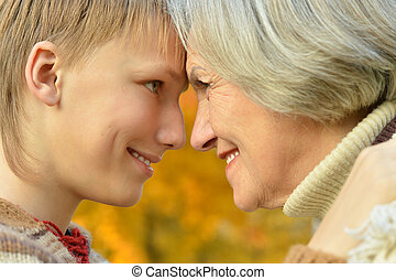 Grandmother with boy in the park