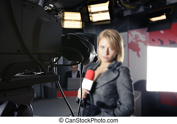 camera and unrecognizable reporter - TV studio with close up...