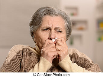 Mature woman fells ill a cold at home