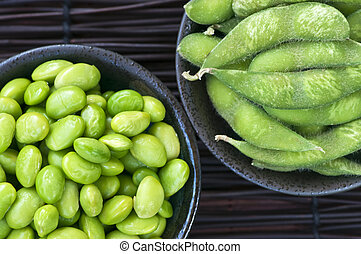 Soy beans in bowls - Edamame soy beans shelled and with pods...