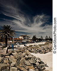 Coastal Town - A town situated on the coast Beach and rocks...