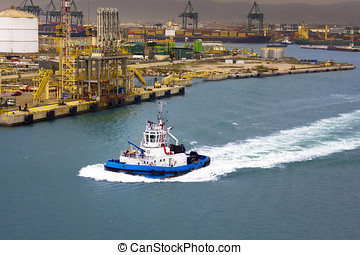 Operating in the Port of Barcelona - Tugs vessel in the port...