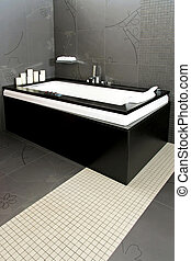 Black bathtub - Big hydro massage bathtub in black bathroom...