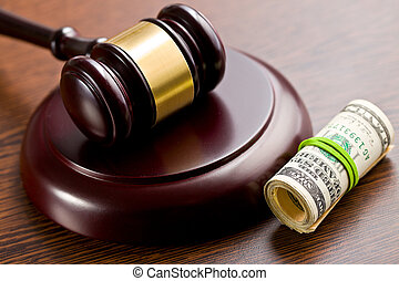 judge gavel with pack of dollars