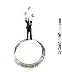 Businessman catching and throwing money symbols on money...