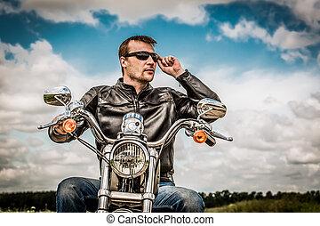 Biker on a motorcycle - Biker man wearing a leather jacket...