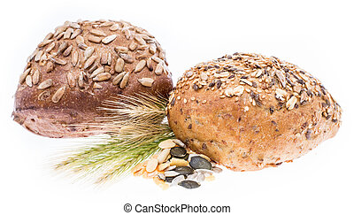 Heap of Rolls with wheat isolated on white background
