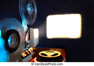 Film Projector - Old 8mm film projector showing the film in...