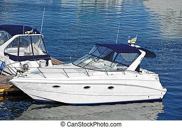 Motor yacht - White motor yacht over harbor pier, Odessa,...