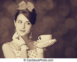 Beautiful women with cup of tea. Photo in retro style with...