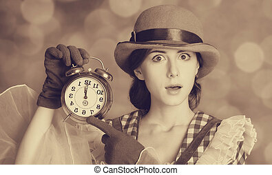 Beautiful women with clock. Photo in retro style with bokeh...