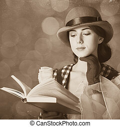 Beautiful women with book Photo in retro style with bokeh at...
