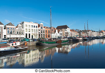 canal in zwolle, netherlands - houseboats and barges in a...