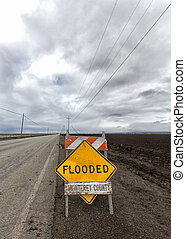 Flooded Roadway Sign Vertical Image in Monterey County,...