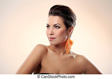 Glamour and gorgeous brunette with feather earring -...