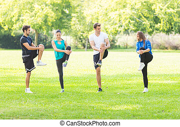 Friends work out in park
