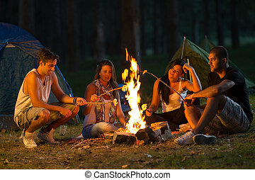 Friends camping Selected focus on