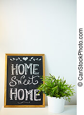 Home concept - Photo of small board with message about home