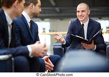 Business negotiations - Group of young businessmen...