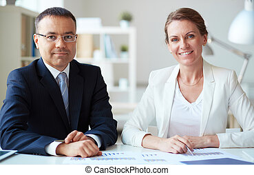 Business associates - Two mature business partners looking...