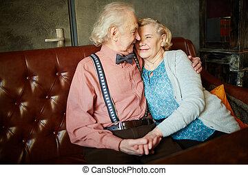 Romantic scene - Portrait of retired couple in smart clothes...