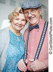 Sweethearts - Portrait of retired couple in smart clothes...