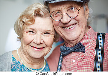 Cheerful seniors - Portrait of senior couple in smart...
