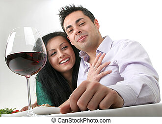 Romantic dinner - Couple having a romantic dinner with red...