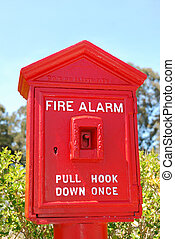 Fire Alarm Box - Fire alarm red box shown outside with green...