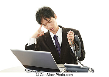 Frustrated Asian businessman - Tired and stressed Asian...