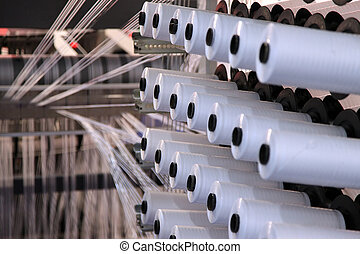 textile manufacturing - large group of bobbin thread cones...