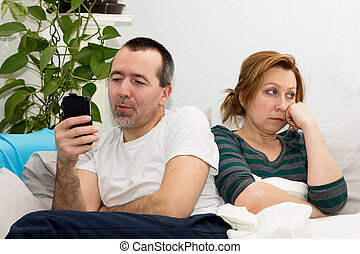 Man with mobile phone with languidly woman
