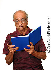 Reading - Old Indian Immigrant reading a blue book