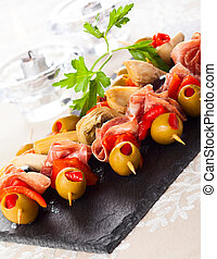 Antipasti skewers with olives,red pepper,artichoke hearts...