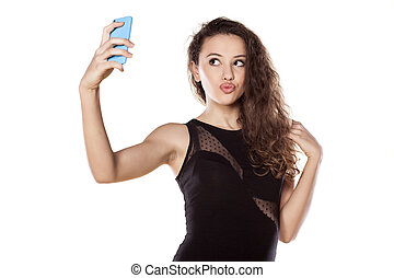 selfies - pretty teen girl taking selfies with her smart...