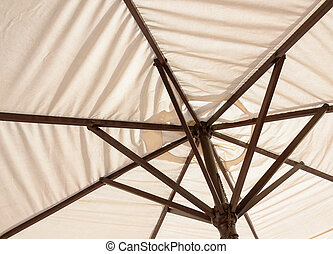 Off-white parasol seen from underneath