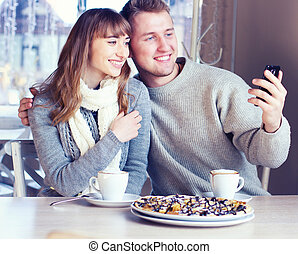 Young Couple in Love in cafe - Portrait of Beautiful Young...